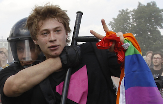 Police detain a gay rights activist during a Gay Pride event in St. Petersburg